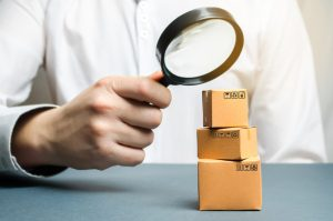 magnifying glass on boxes