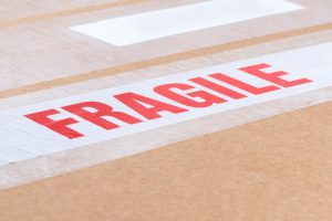fragile sticker on a box